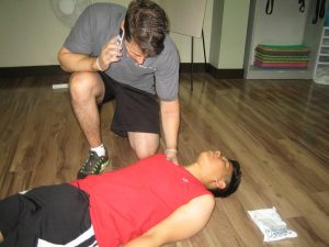 Assess the level of consciousness during first aid