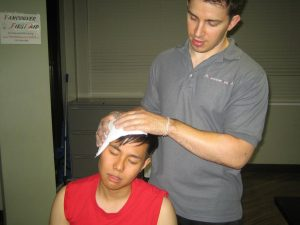 What are the indications of a head injury after a fall?